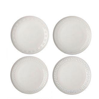 Set of Four Pierced Plates